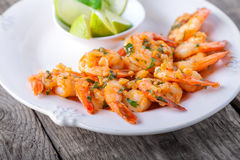Fried Prawns served on the plate. With lime Royalty Free Stock Photos