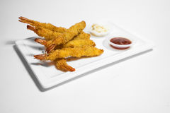 Fried Prawns. Shot of fried prawns with ketchup and tar tar sauce on white background Royalty Free Stock Photo