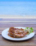 The fried prawns with tamarind sauce in plate with beach backgro Royalty Free Stock Photo