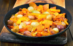 Fried pumpkin, onion, garlic and pepper in frying pan, close up Stock Photography