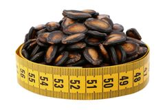 Fried pumpkin seed and meter Royalty Free Stock Photography