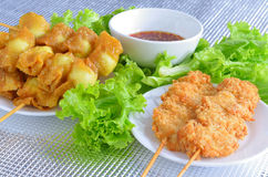 Fried quail egg wrapped in wanton sheet and fried chicken Stock Image