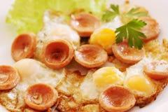 Fried quail eggs Stock Photos