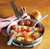 Fried quail eggs with cherry tomatoes Royalty Free Stock Image