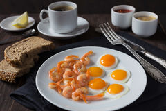 Fried quail eggs with shrimps Stock Photo