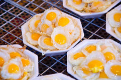 Fried quail eggs. Are street food Stock Photos