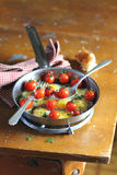 Fried quail eggs with tomatoes and mozzarela Stock Photos