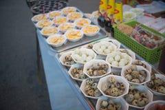 Fried quails eggs shop, fair on urban of Thailand stock images