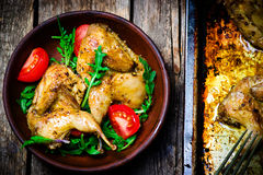The fried quails with salad Royalty Free Stock Photos