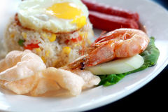 Fried rice. With egg, sausages and prawn royalty free stock photo