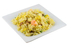 Fried Rice. A plate of fried rice isolated in solid white background stock image