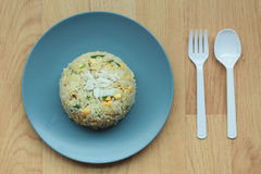 Fried rice. On blue disk Royalty Free Stock Images