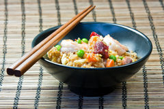 Fried rice in a bowl. Mixed fried rice in a bowl with chopsticks Stock Photos