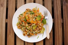 Fried rice with carrot and brussel sprouts in white plate Royalty Free Stock Photos