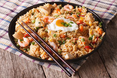 Fried rice with chicken, prawns, egg and vegetables closeup hori. Asian fried rice with chicken, prawns, egg and vegetables close-up horizontal Royalty Free Stock Photos
