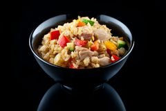 Fried rice with chicken and vegetables isolated on black Royalty Free Stock Photography