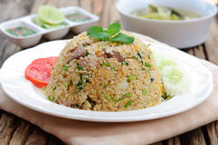 Fried rice. With chili sauce and soup on wooden table stock photo