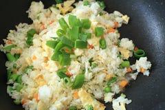 Fried rice cooking in hot iron pan. Asian food ingredient.  royalty free stock image