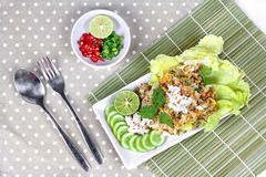Fried rice with crab topped streamed crab,halve green lemon,sliced cucumber,lettuce and coriander  served  spicy  sour filling sid Royalty Free Stock Photos