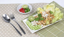 Fried rice with crab topped streamed crab,halve green lemon,sliced cucumber,lettuce and coriander  served  spicy  sour filling sid Royalty Free Stock Photography
