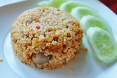 Fried rice with crispy pork and chili paste Stock Photos