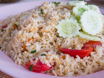 Fried rice with cucumber on topping.  Royalty Free Stock Images