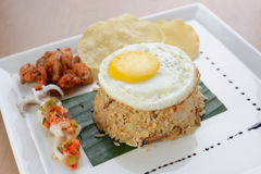 Fried rice with egg, chicken and prawn cracker Royalty Free Stock Photo