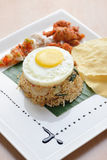 Fried rice with egg, chicken and prawn cracker Stock Photos