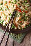 Fried rice with egg, peas, carrots close-up vertical top view Royalty Free Stock Images