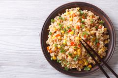 Fried rice with eggs, corn and parsley close-up horizontal top v Royalty Free Stock Photos