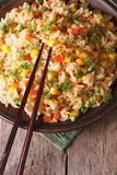 Fried rice with eggs, corn and spices and chopsticks Stock Image