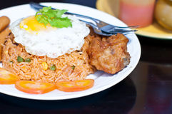 Fried rice with fried egg fried chicken. Fried rice with fried egg and fried chicken Royalty Free Stock Photo