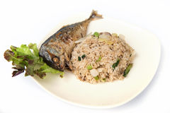 Fried rice with fried mackerel. Stock Photo