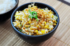 Fried rice with garlic in a black bowl Stock Photo