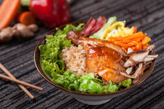 Fried rice with grilled chicken leg and mushroom in asia Royalty Free Stock Photo