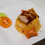Fried rice with grilled pork and sausage. And tomato Royalty Free Stock Photo
