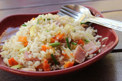 Fried rice with ham. On red plate stock image