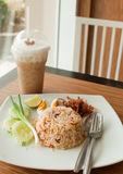 Fried rice with iced coffee Stock Photos