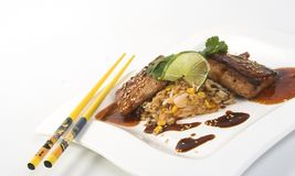 Fried rice and mahi. With soy sauce royalty free stock photos