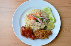 Fried rice with mixed seafood and crispy chicken on plate. Fried rice with mixed seafood and crispy chicken on white plate Royalty Free Stock Photos