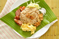 Fried rice mixed with shrimp paste on banana leaf Royalty Free Stock Image