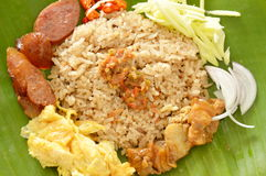 Fried rice mixed with shrimp paste on banana leaf Royalty Free Stock Photography