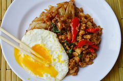 Fried rice noodle and spicy minced pork with basil leaf topping egg Royalty Free Stock Photo