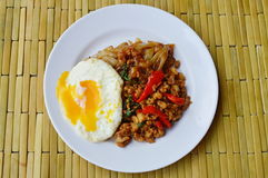 Fried rice noodle and spicy minced pork with basil leaf topping egg Stock Photos