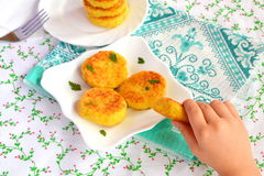 Fried rice patties on the plate. Easy vegetarian recipe. Child takes one cutlet Stock Photo