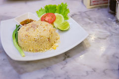 Fried rice on plate. Thai food, fried rice on the plate with cucumber, leman, and a slice of tomato Stock Images