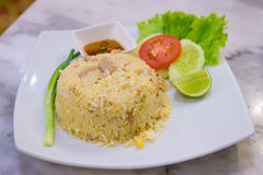 Fried rice on plate. Thai food, fried rice on the plate with cucumber, leman, and a slice of tomato Stock Image