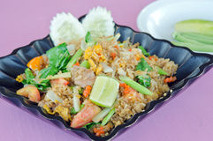 Fried rice with pork, cucumber, egg, vegetable and lime royalty free stock photos