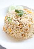 Fried rice with pork. And cucumber garnish in Asia stock photo