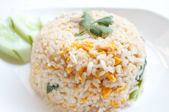 Fried rice with pork. And cucumber garnish in Asia Royalty Free Stock Photography